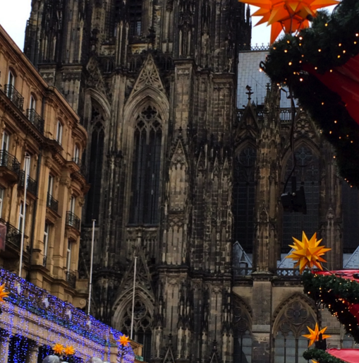 <p>Cologne has a few markets, and I particularly loved the one right at the base of the cathedral. However, a bit further up the street, you can find a smaller version that is less crowded and that boasts a beautiful merry–go-round and Christmas decorations galore.</p>