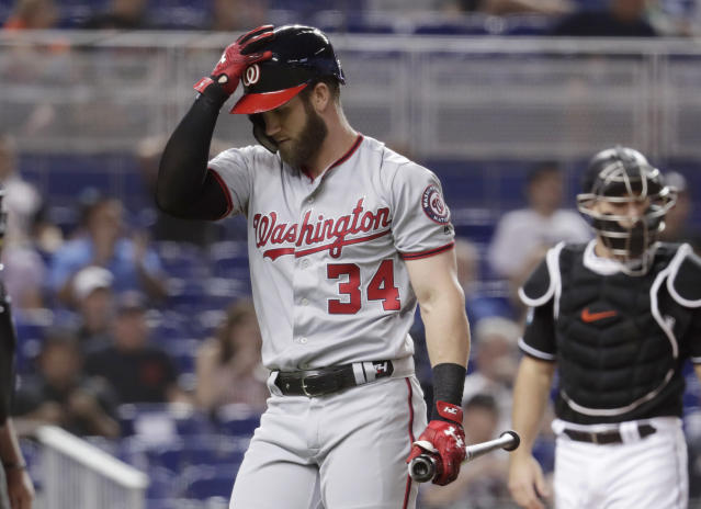 Washington Nationals' Bryce Harper (34) walks to the dugout after striking out during the first inning of a baseball game against the Miami Marlins, Friday, May 25, 2018, in Miami. (AP Photo/Lynne Sladky)
