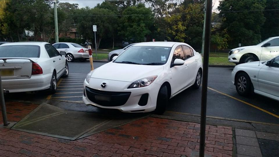 Pictured is a Mazda parked on an angle outside shops in the Sydney suburb of Telopea.