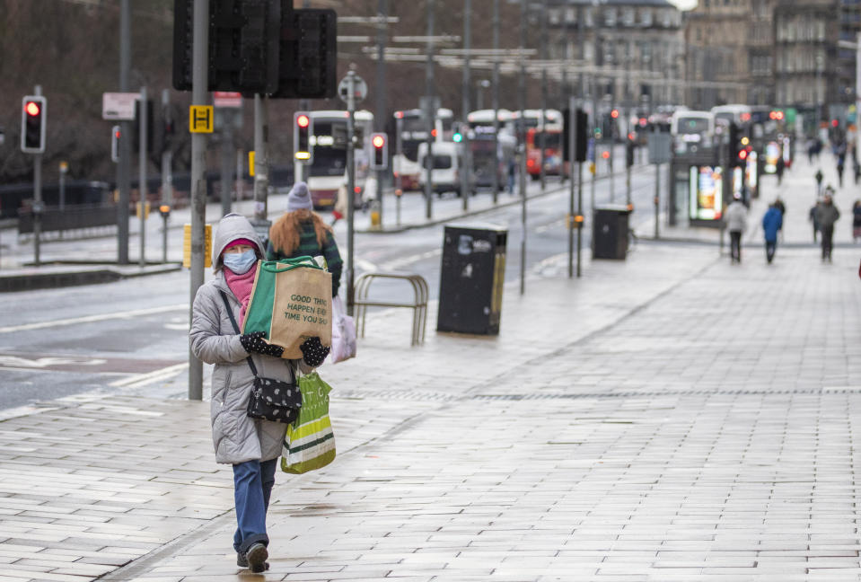 The usually busy Princes Street in Edinburgh is deserted as people stay home on Tuesday. (SWNS)