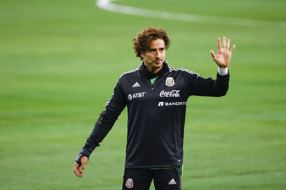 May 29, 2021; Arlington, Texas, USA; Mexico goalkeeper Guillermo Ochoa warms up before the game against Iceland at AT&T Stadium. Mandatory Credit: Erich Schlegel-USA TODAY Sports