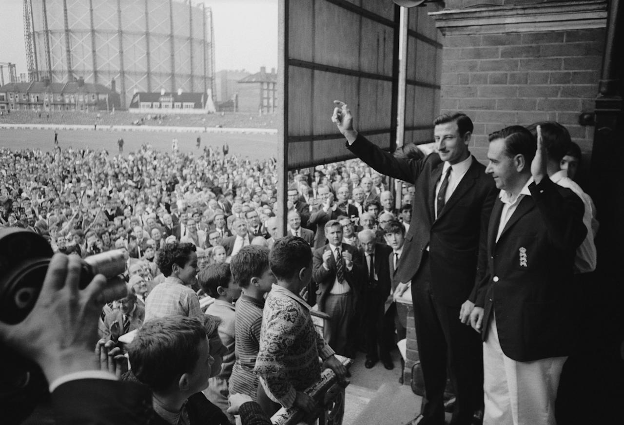 27th August 1968:  CHECK HI-RES IF SUPPLYING DIGITALLY England captain, (extreme right), Colin Cowdrey (1932 - 2000) and his Australian counterpart Bill Lawry acknowledge the cheers of the crowd after England won the 5th and final Test Match at The Oval.  (Photo by Central Press/Getty Images)