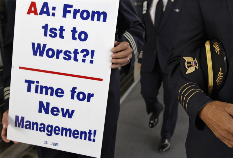 Over 200 American Airline pilots marched on a picket line at O'Hare International Airport Thursday, Sept. 20, 2012 in Chicago, Ill. Pilots and other employees are unhappy with American because the airline has cut jobs and benefits and changed work rules as it reorganizes while under bankruptcy protection. (AP Photo/M. Spencer Green)