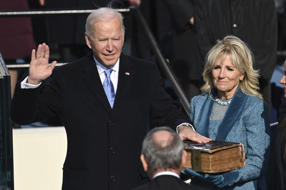 Joe Biden is sworn in as the 46th president of the United States by Chief Justice John Roberts as Jill Biden holds the Bible during the 59th Presidential Inauguration at the U.S. Capitol in Washington, Wednesday, Jan. 20, 2021.(Saul Loeb/Pool Photo via AP)