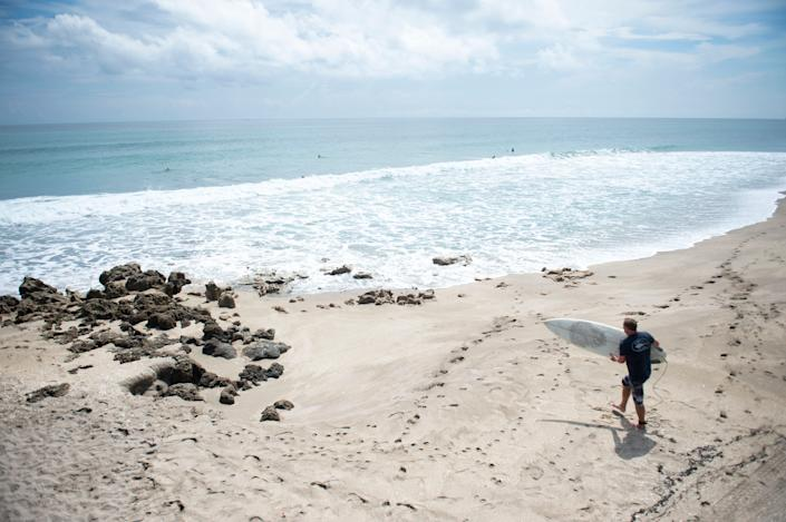 Surfers search for waves ahead of Hurricane Dorian on Aug. 29, 2019, at Chastain Beach on Hutchinson Island, Fla.