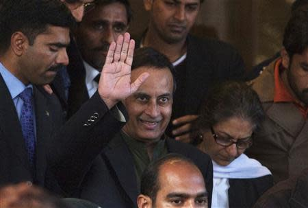 File photo of former Pakistani ambassador to the United States Haqqani waving in Islamabad