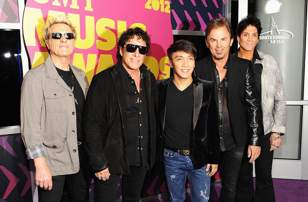 Journey -- sans former lead singer Steve Perry, who left the band for a second time in 1998 -- posed for pics on the purple carpet before heading inside the Bridegstone Arena to prepare for their performance alongside Rascal Flatts.