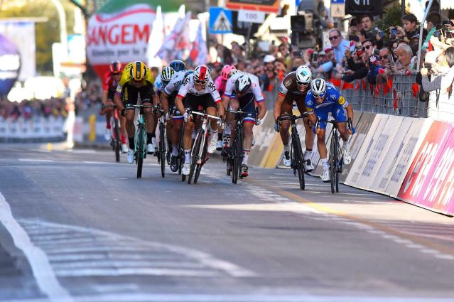 French rider Julian Alaphilippe, right, sprints ahead of Oliver Naesen, at his left, at the end of the 291-kilometer (181-mile) route along the Italian Riviera for the 110th edition of the Milano-Sanremo cycling classic, in Sanremo, Italy, Saturday, March 23, 2019. (Dario Belinghieri/ANSA via AP)