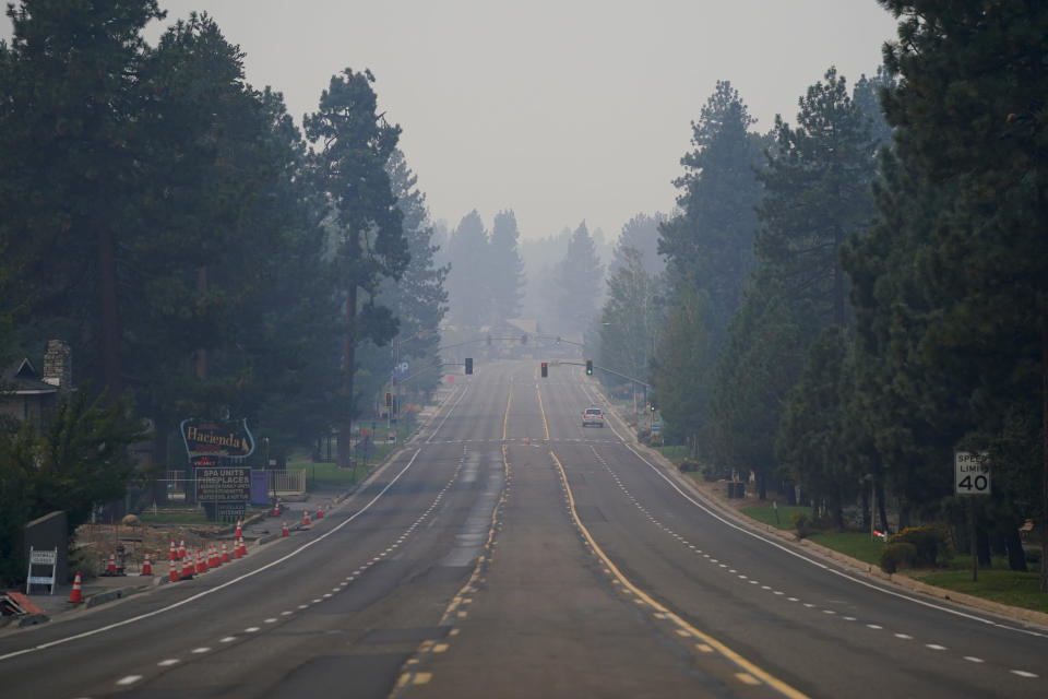 A truck drives along Highway 50 in South Lake Tahoe, Calif., Thursday, Sept. 2, 2021. Better weather on Thursday helped the battle against a huge California forest fire threatening communities around Lake Tahoe, but commanders warned firefighters to keep their guard up against continuing dangers. (AP Photo/Jae C. Hong)