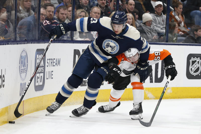 Columbus Blue Jackets' Stefan Matteau, left, and Philadelphia Flyers' Mark Friedman chase the puck during the second period of an NHL hockey game Thursday, Feb. 20, 2020, in Columbus, Ohio. (AP Photo/Jay LaPrete)