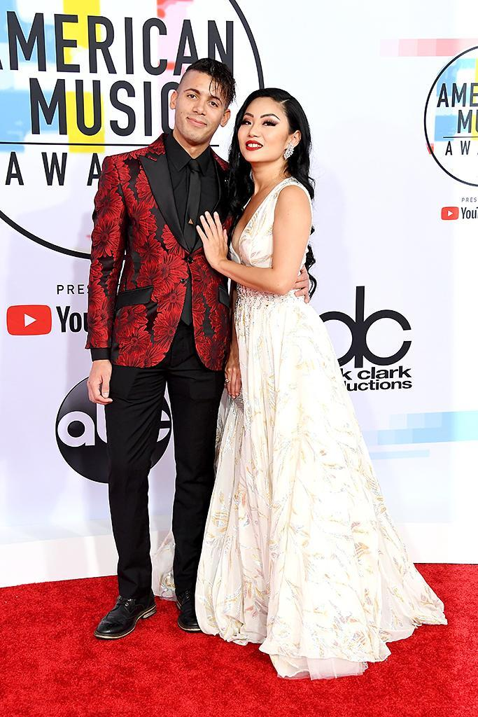 <p>Rambo Jennings (L) and Tina Guo attend the 2018 American Music Awards at Microsoft Theater on October 9, 2018 in Los Angeles, California. (Photo by Steve Granitz/WireImage) </p>