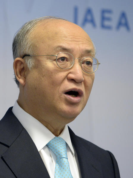 "The Director General of the International Atomic Energy Agency, IAEA, Yukiya Amano of Japan speaks during a news conference after the IAEA board of governors meeting at the International Center in Vienna, Austria, Monday, June 3, 2013. Yukiya Amano of the International Atomic Energy Agency says negotiations with Iran to restart the probe ""have been going around in circles."" He says he is addressing his appeal ""with a sense of urgency.""Amano spoke Monday at the start of a 35-nation board meeting of his International Atomic Energy Agency. His comments were focused on Parchin, a site southeast of Tehran where the IAEA suspects Iran worked on nuclear arms. (AP Photo/Hans Punz)"