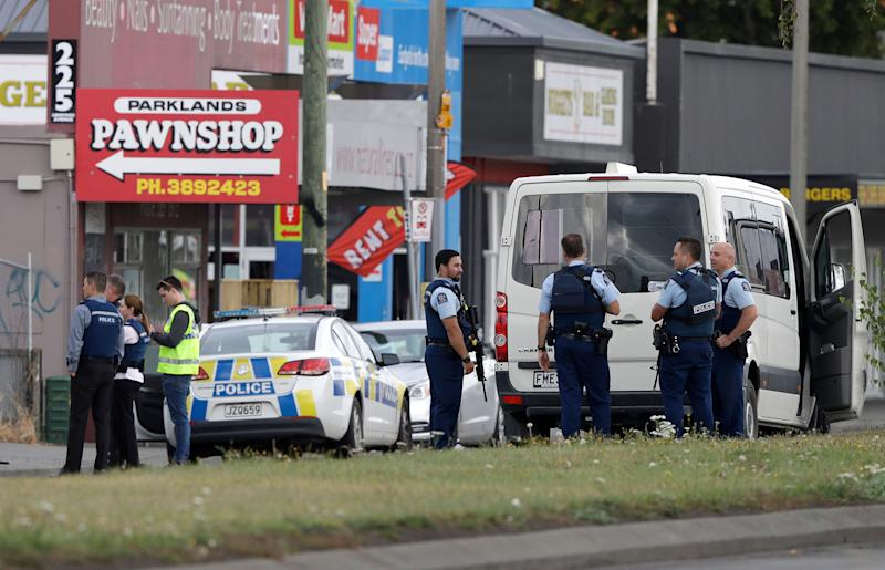 Police stand outside a mosque in Christchurch after a mass shooting in New Zealand on March 15, 2019.