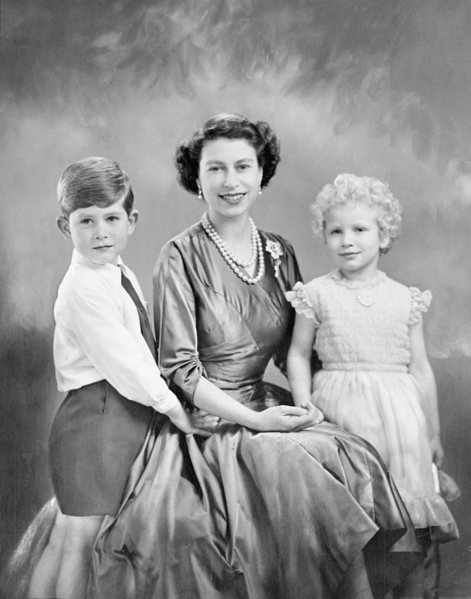 A portrait of Queen Elizabeth with her two oldest children.