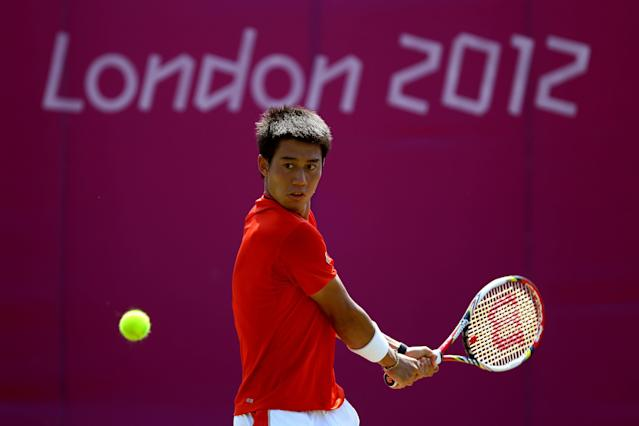 LONDON, ENGLAND - JULY 26: Kei Nishikori of Japan plays a backhand during the practice session ahead of the 2012 London Olympic Games at the All England Lawn Tennis and Croquet Club in Wimbledon on July 26, 2012 in London, England. (Photo by Clive Brunskill/Getty Images)
