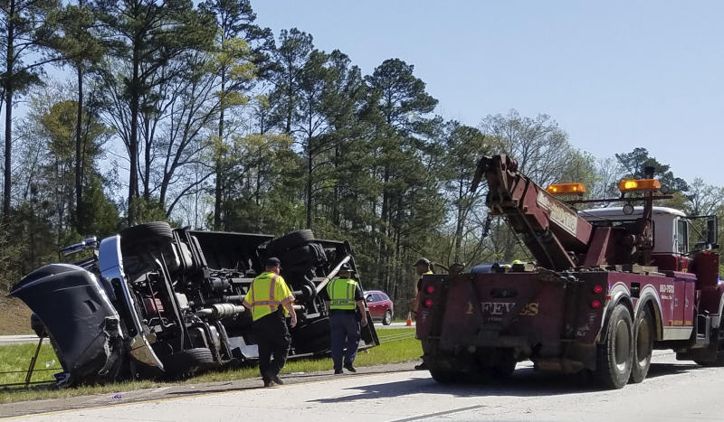 Masters golf fans hurt when bus overturns on interstate