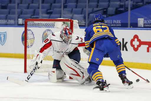 Buffalo Sabres defenseman Brandon Montour (62) is stopped by Washington Capitals goalie Ilya Samsonov (30) during the second period of an NHL hockey game Thursday, Jan. 14, 2021, in Buffalo, N.Y. (AP Photo/Jeffrey T. Barnes)
