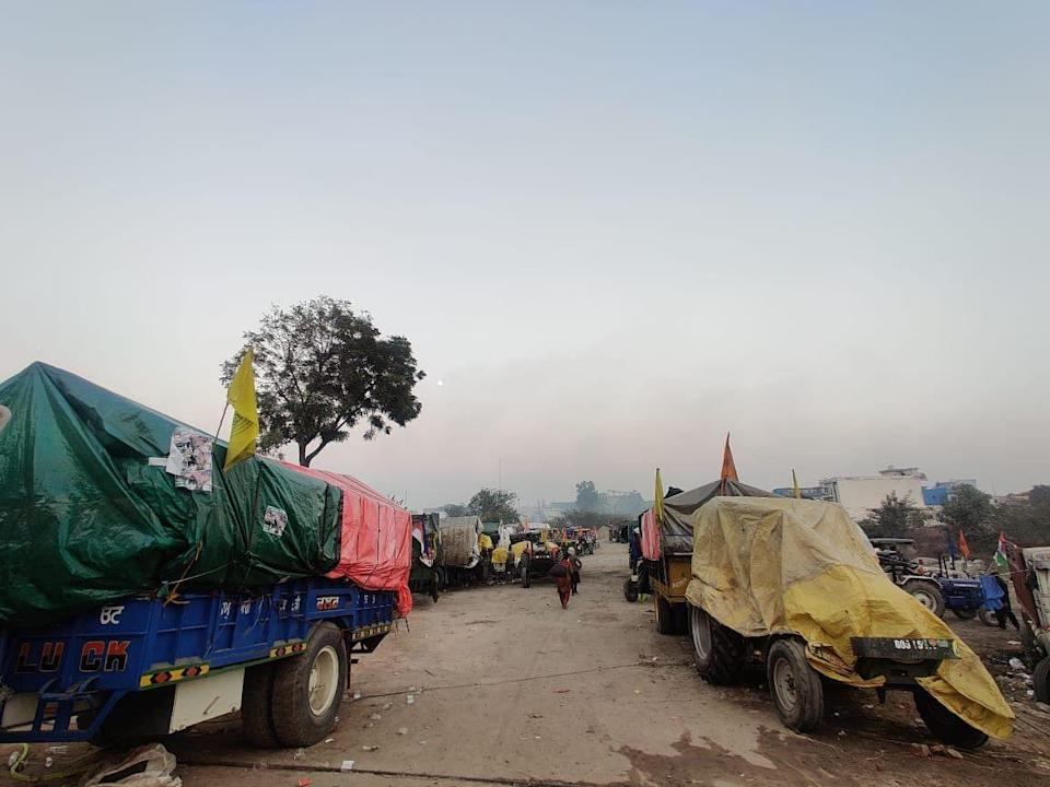 Tractors with Nishan Sahib flags parked at the protest site in Singhu.
