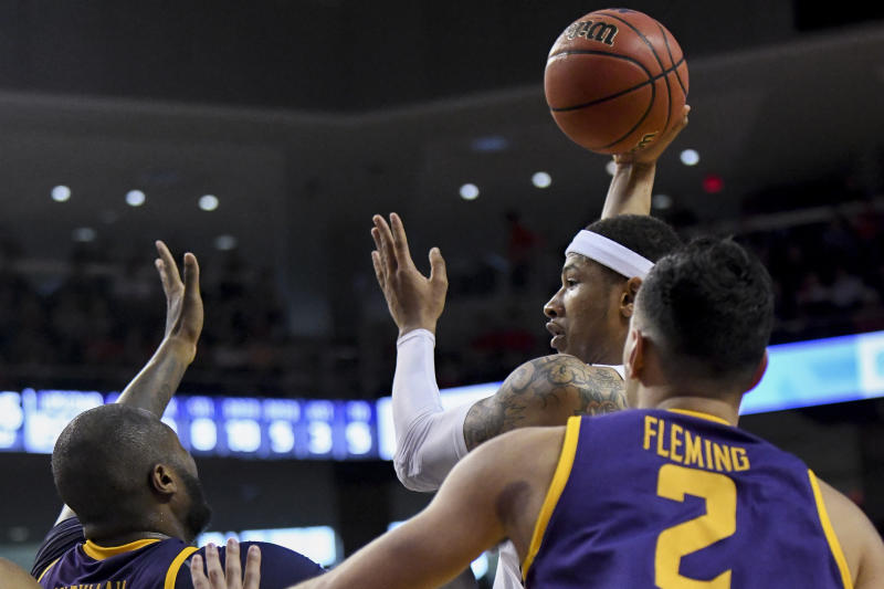 Auburn guard Samir Doughty (10) passes the ball around Lipscomb center Ahsan Asadullah (23) and guard Andrew Fleming (2) during the second half of an NCAA college basketball game Sunday, Dec. 29, 2019, in Auburn, Ala. (AP Photo/Julie Bennett)