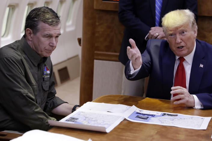 """FILE - In this Sept. 9, 2019, file photo, President Donald Trump participates in a briefing about Hurricane Dorian with North Carolina Gov. Roy Cooper, left, aboard Air Force One at Marine Corps Air Station Cherry Point in Havelock, N.C. President Donald Trump demanded Monday, May 25, 2020, that North Carolina's Democratic governor sign off """"immediately"""" on allowing the Republican National Convention to move forward in August with full attendance despite the ongoing COVID-19 pandemic. Trump's tweets Monday about the RNC, planned for Charlotte, come just two days after the North Carolina recorded its largest daily increase in positive cases yet.(AP Photo/Evan Vucci)"""