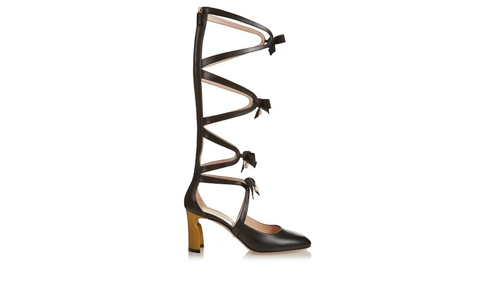 """<p>Gucci bow embellished gladiator leather pumps, $1924, <a href=""""http://www.matchesfashion.com/us/womens/the-style-report/2016/02/new-york-fashion-week-issue/10-rules-style-leandra-medine-man-repeller"""" rel=""""nofollow noopener"""" target=""""_blank"""" data-ylk=""""slk:Matches Fashion"""" class=""""link rapid-noclick-resp"""">Matches Fashion</a></p>"""