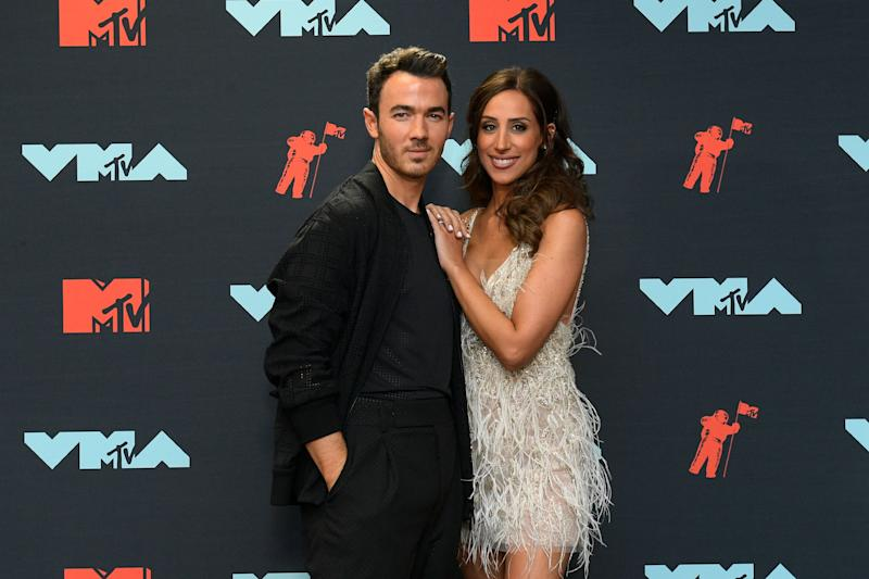 Kevin Jonas and his wife at the video music awards