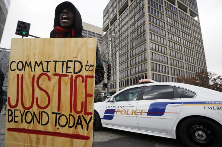 A demonstrator shouts during a protest near the courthouse in Clayton, Mo. last week. (Jim Young/Reuters)