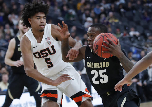 Colorado's McKinley Wright IV drives around Oregon State's Ethan Thompson during the first half of an NCAA college basketball game in the quarterfinals of the Pac-12 men's tournament Thursday, March 14, 2019, in Las Vegas. (AP Photo/John Locher)