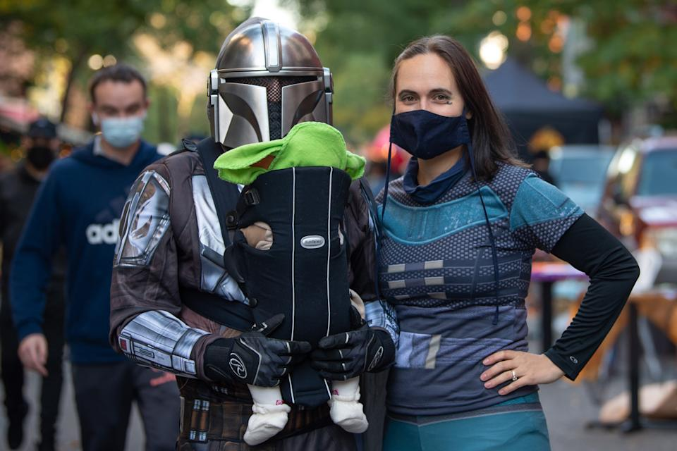 NEW YORK, NEW YORK - OCTOBER 31: A family dressed as Disney Plus' The Mandalorian poses in the East Village on October 31, 2020 in New York City. Many Halloween events have been canceled or adjusted with additional safety measures due to the ongoing coronavirus (COVID-19) pandemic. (Photo by Alexi Rosenfeld/Getty Images)