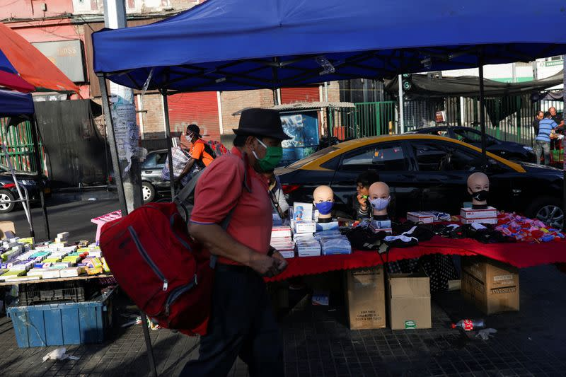 A stall with security elements is seen in the street market, during a preventive quarantine after the outbreak of the coronavirus disease (COVID-19), in Santiago
