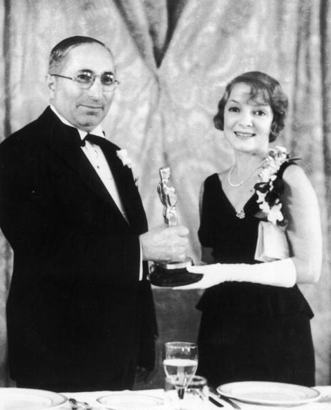 "<p>Here, she posed with her award and wore a classic black dress, pearl necklace, and elbow-length gloves. Another fun fact? In 1977, she was the <a href=""https://www.mylifetime.com/she-did-that/february-19-1977-helen-hayes-became-the-first-female-egot"" rel=""nofollow noopener"" target=""_blank"" data-ylk=""slk:first woman to get an EGOT"" class=""link rapid-noclick-resp"">first woman to get an EGOT</a>. You go, Helen!</p>"