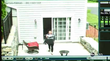 Surveillance video shows Shayanna Jenkins leaving the house with a trash bag the day after Odin Lloyd's murder.