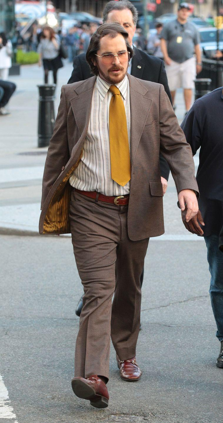 <p>Yes, Christian Bale is supporting a very bad head of hair here. But for his role in <em>American Hustle</em>, the actor decided to shave his head so the makeup department could add a bad toupee every day of filming. </p>