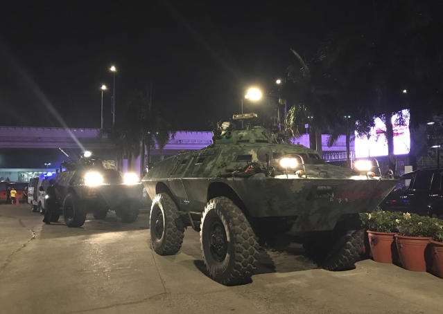 <p>Military vehicles are positioned outside the Resorts World Manila complex early Friday, June 2, 2017, in Manila, Philippines. (Photo: Bullit Marquez/AP) </p>