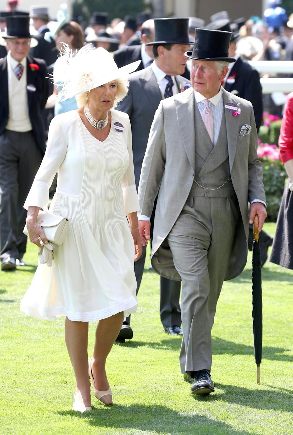 <p>Camilla, like Kate, chose an all-white look. But while Kate opted for a small hat, the Duchess of Cornwall made a splash with a wide-rimmed number. Meanwhile Prince Charles worked a grey three-piece suit, with pale pink tie, and black top hat. <br><em>[Photo: Getty]</em> </p>