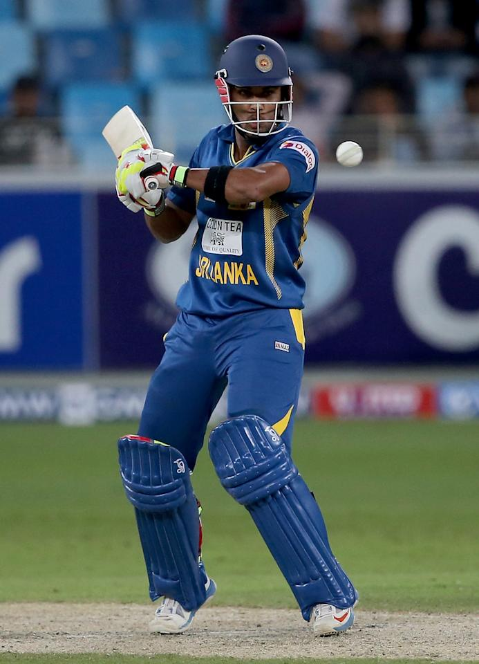 DUBAI, UNITED ARAB EMIRATES - DECEMBER 20:  Dinesh Chandimal of Sri Lanka bats during the second One-Day International (ODI ) match between Sri Lanka and Pakistan at the Dubai Sports City Cricket Stadium on December 20, 2013 in Dubai, United Arab Emirates.  (Photo by Francois Nel/Getty Images)