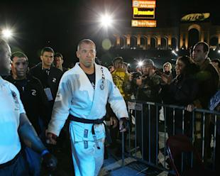 Royce Gracie walks to the cage before a 2007 fight against Kasushi Sakuraba - his last pro fight. (Getty)