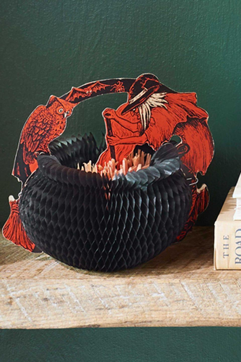 <p>Prone to damage—it's very rare to find an example with an intact arch—this 1929 honeycomb witch and cauldron from Beistle  originally came in three different sizes. This—the middle-sized version—stirs up an impressive value of $350.</p>