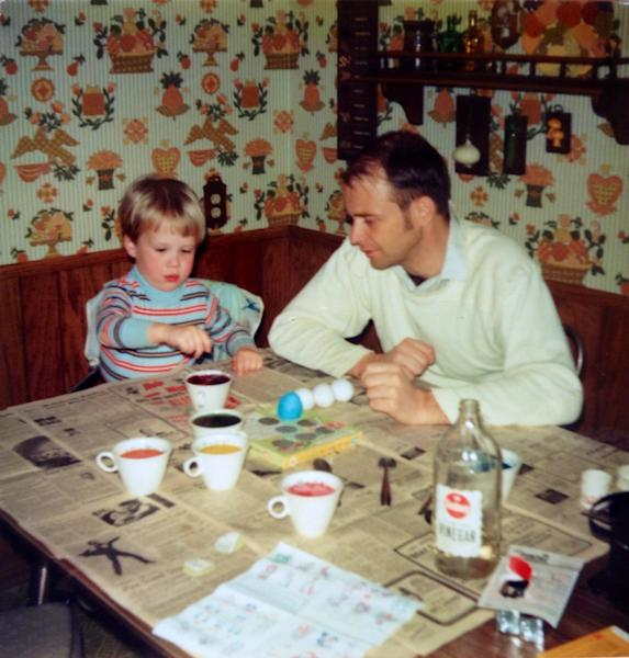 In this 1974 photo provided by Mary Linnerooth Gonzalez, her brother, Pete, colors Easter eggs with their father, Dave Linnerooth at their home in Rochester, Minn. (AP Photo/Mary Linnerooth Gonzalez)