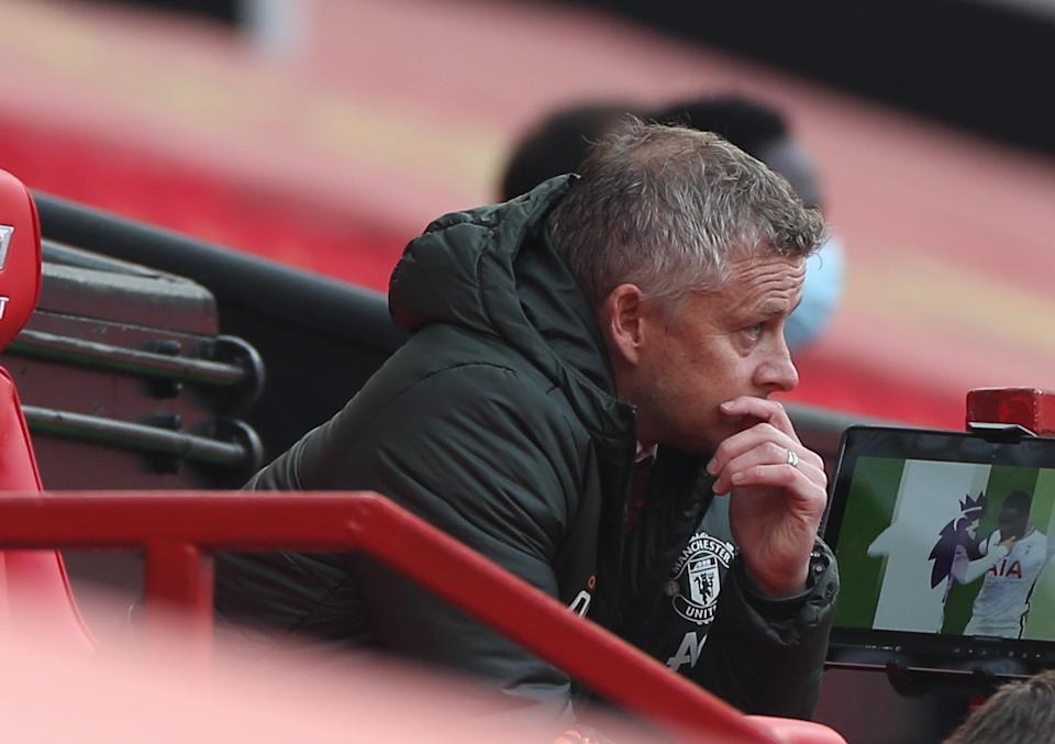 MANCHESTER, ENGLAND - OCTOBER 04: Manager Ole Gunnar Solskjaer of Manchester United watches from the dugout during the Premier League match between Manchester United and Tottenham Hotspur at Old Trafford on October 04, 2020 in Manchester, England. Sporting stadiums around the UK remain under strict restrictions due to the Coronavirus Pandemic as Government social distancing laws prohibit fans inside venues resulting in games being played behind closed doors. (Photo by Matthew Peters/Manchester United via Getty Images)