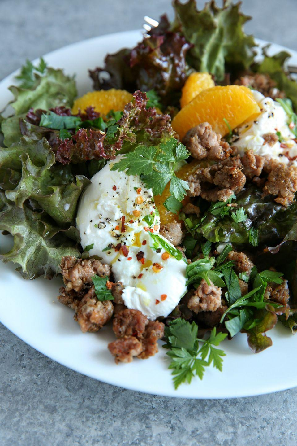 """<p>Greens get a boost from salty, sweet, spicy and creamy fixings.</p><p>Get the recipe from <a href=""""https://www.delish.com/cooking/recipe-ideas/recipes/a48085/crispy-sausage-and-burrata-salad-recipe/"""" rel=""""nofollow noopener"""" target=""""_blank"""" data-ylk=""""slk:Delish"""" class=""""link rapid-noclick-resp"""">Delish</a>.<br></p>"""