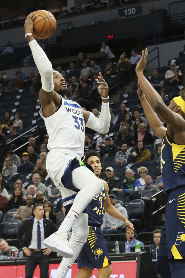 Minnesota Timberwolves' Robert Covington, left, shoots as Indiana Pacers' Myles Turner defends in the first half of an NBA basketball game Wednesday, Jan. 15, 2020, in Minneapolis. (AP Photo/Jim Mone)