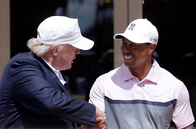 Donald Trump shakes hands with Tiger Woods during a ribbon cutting for the new Tiger Woods Villa at the Trump National Doral golf course, Wednesday, March 5, 2014 in Doral, Fla. (AP Photo/Wilfredo Lee)