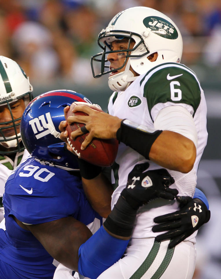 New York Giants defensive end Jason Pierre-Paul (90) sacks New York Jets quarterback Mark Sanchez (6) during the first half of a preseason NFL football game on Saturday, Aug. 18, 2012, in East Rutherford, N.J. (AP Photo/Rich Schultz)