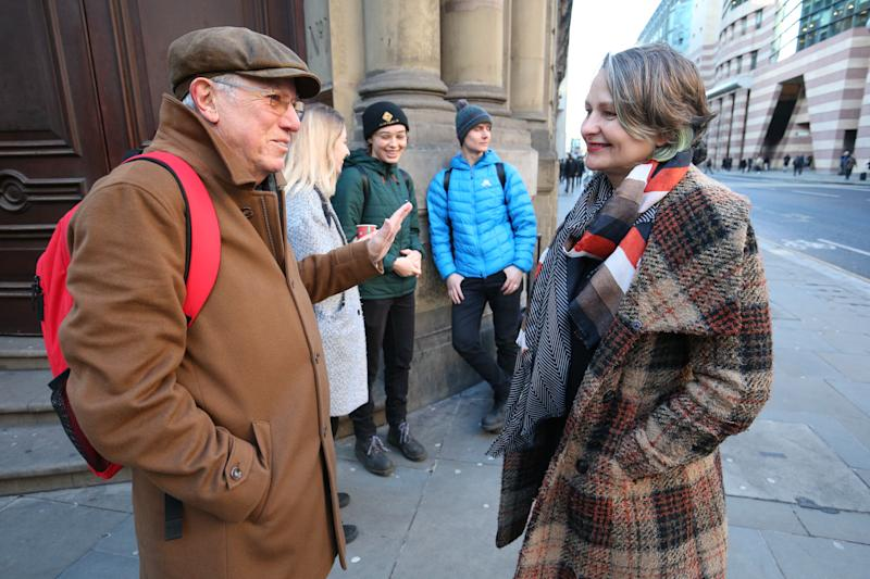 Sir David King (left) with Claudia Fisher, 57, a business woman from Brighton, one of the defendants, arriving at the City of London Magistrates' Court, she was one of the protesters who were arrested on 10 October 2019, during a peaceful demonstration - in which they glued themselves to the concourse between the DLR station and City Airport in east London.