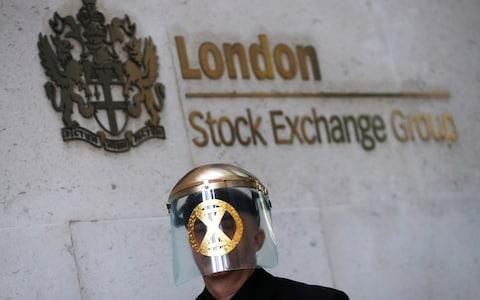 A man takes part in a demonstration at the London stock exchange during an Extinction Rebellion protest - Credit: Simon Dawson/Reuters