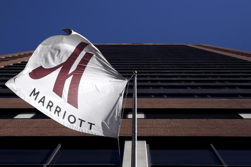 File photo of a Marriott flag hanging at the entrance of the New York Marriott Downtown hotel in Manhattan, New York