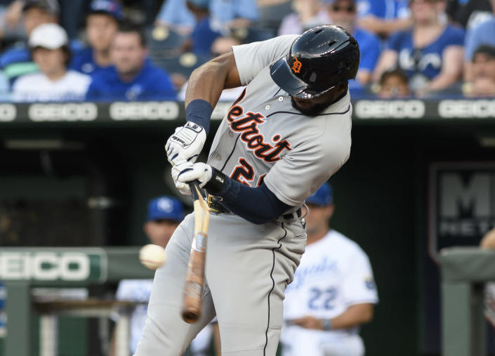 Detroit Tigers' Niko Goodrum breaks his bat on a two-RBI single during the first inning of a baseball game against the Kansas City Royals in Kansas City, Mo., Monday, June 14, 2021. (AP Photo/Reed Hoffmann)