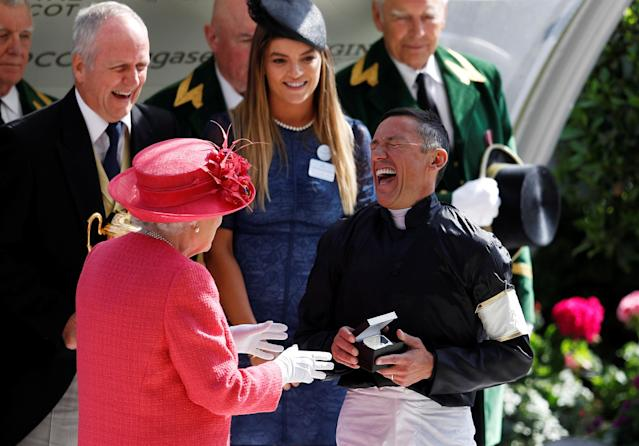 Horse Racing - Royal Ascot - Ascot Racecourse, Ascot, Britain - June 21, 2018 Frankie Dettori with Britain's Queen Elizabeth after winning the 4.20 Gold Cup riding Stradivarius REUTERS/Peter Nicholls