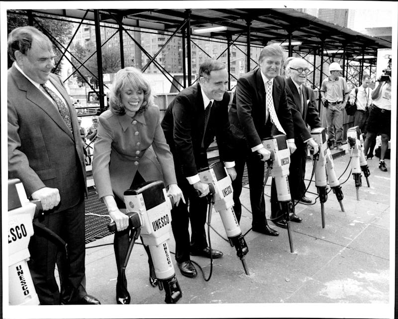 Donald Trump's groundbreaking ceremony with electric jackhammers for the new Trump International Hotel and Tower at Columbus Circle, with Lt. Gov. Betsey McCanney, Mayor Rudy Giuliani and architect Philip Johnson on June 21, 1995.